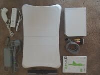 Nintendo Wii complete with game board and Wii fit pal ex condition
