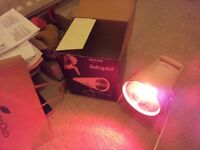 Philips Infra red heater for muscle aches etc Gives a nice warm glow to muscle aches
