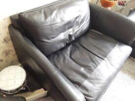 Black leather sofa, cuddle chair