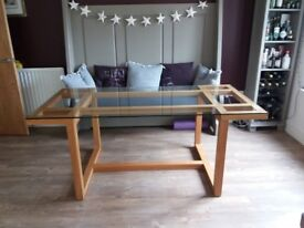 Solid oak dining table with glass top