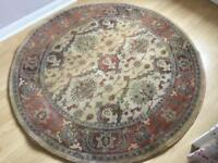 Large round rug in rust and beige from next