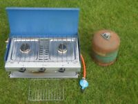 Camping Gas Camping Chef two-burner cooker, grill and regulator. Bottle, half full. £15.