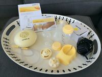 Medela Swing electric breast pump with complete set of accessories