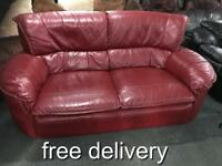 As new red leather 2 seater sofa