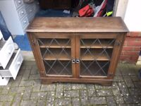 Glass fronted wooden bookcase cabinet