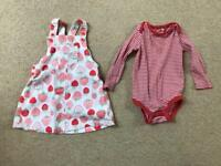 6-9 months strawberry print pinafore dress with stripe vest.
