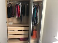 Ikea Pax triple wardrobe with mirror doors, drawers and hanging rails. Excellent condition.