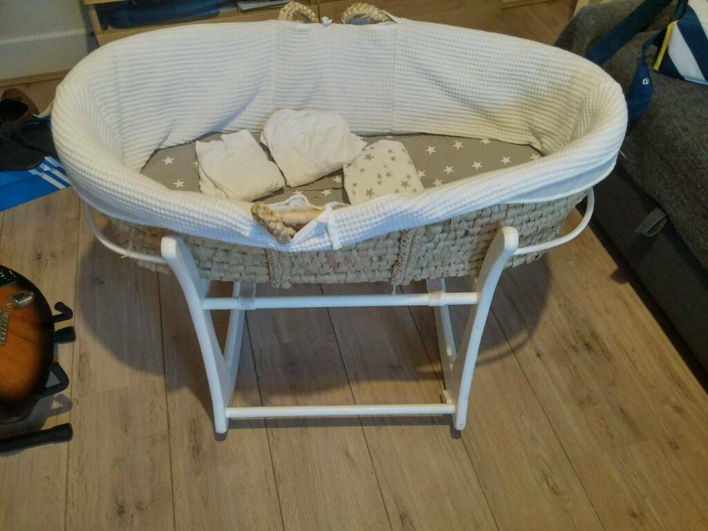 Moses Basket, folding stand, and waterproof with four sheets. USED LESS THEN 5 TIMES