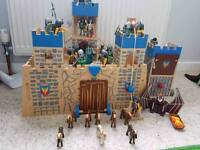 Wooden play fort with 2 sets of Playmobil soldiers