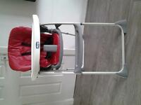 chicco high chair with storage basket & reclines for comfort