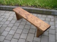 A plain wooden garden bench.