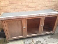 Wooden rabbit hutch. Quite large, with separate sleeping area.