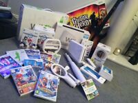 Wii Console + Wii Fit + Guitar Hero + 10 Wii Games. Items in excellent condition/ original packaging