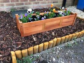 Brand new wooden garden planter