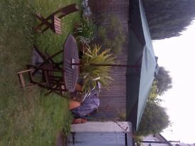 wooden garden table and three folding chairs parasol and stand can deliver