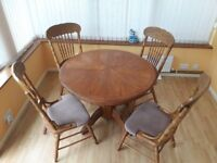 Extending wooden dining table and 5 chairs
