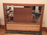 Large mirror with pine surround