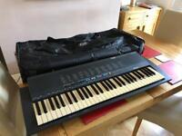 Yamaha PSR-18 keyboard with bag