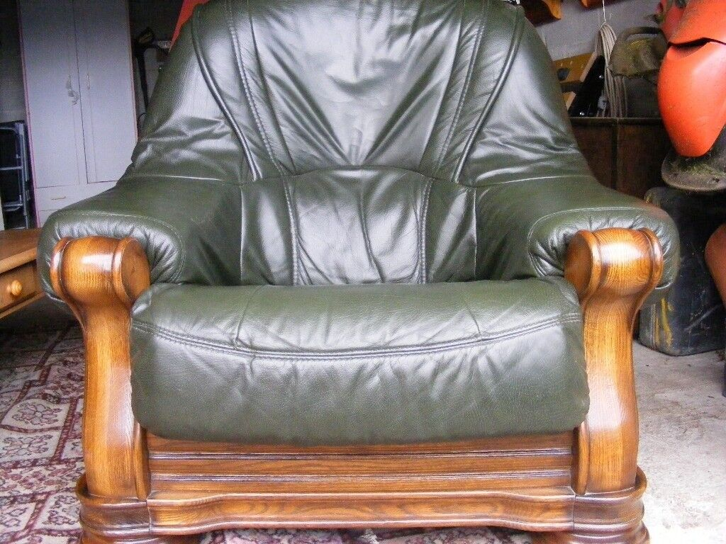 solid oak and bottle green leather armchair