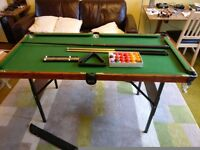 Snooker table with balls and cues