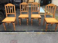 Four chunky solid pine chairs