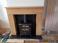 Electric 2kw remote control stove and oak surrounding brand new