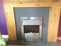 Electric fire and solid oak surround with grey background