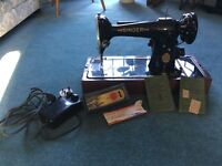 Vintage Singer electric sewing machine with accessories