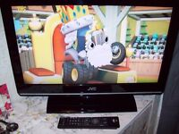 J.V.C FLAT SCREEN 26 INCH WITH BUILT IN FREEVIEW AND BUILD IN HARD DRIVE.