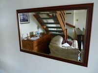 Wooden framed mirror.