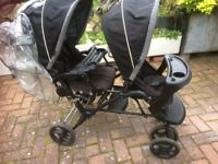 DOUBLE TANDEM GRACO PUSHCHAIR WITH RAINCOVER.