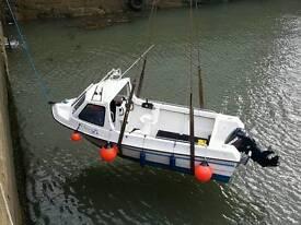 Predator fishing boat and trailer