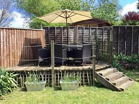 Garden table and 8 chairs in excellent condition.