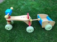 ELC wooden toddlers trike and trailer.