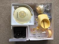Medela Swing Breast Pump plus Extras