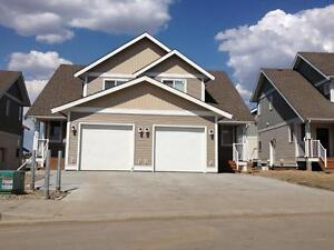BRAND NEW DUPLEXES IN NEW HARVEST VIEW SUBDIVISION