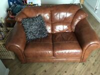 Brown leather 3+2 seater sofa.