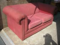 MODERN RED COMFORTABLE 2 SEATER SOFA. ZIPPED CUSHION COVERS. VIEW/DELIVERY AVAILABLE