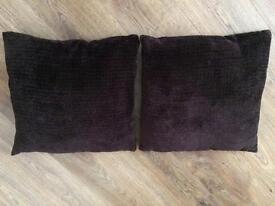 Two brown sofa cushions