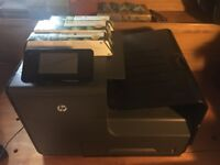 HP Officejet Pro X551dw printer and ink cartridges