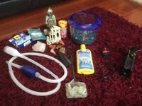 Mixture of fish tank accessories, filter, cleaner, tap safe and fish food