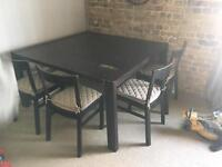 Big dark wood dining table with 4 chairs