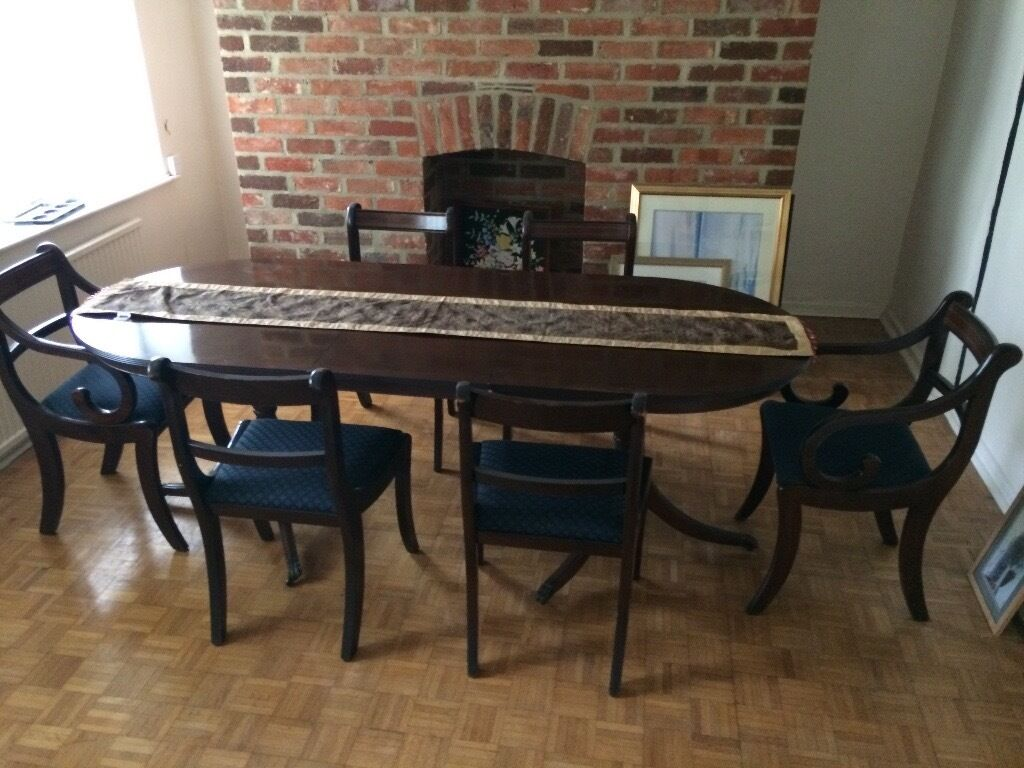 Reproduction mahogany dining table and six chairs