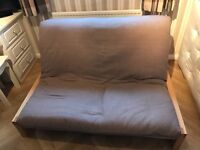 Futon Company Futon.Excellent Quailty. Beige/light brown mattress included. Very good quality. Yeah