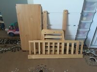 Swinging cot bed