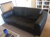 Black leather-look sofa