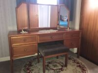Tri folding mirror good quality dressing table and stool .