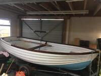 12ft 6 fibre glass boat on refurbished trailer.