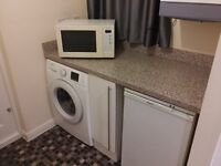 A Panasonic combination (Oven Grill and microwave) microwave oven