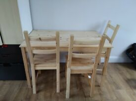 Pine dining table with 4 chairs . Good condition barely used